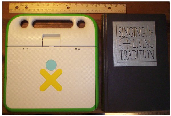 XO laptop and Unitarian Universalist hymnal, with ruler