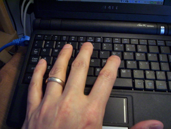 Asus Eee PC keyboard with my hand by comparison