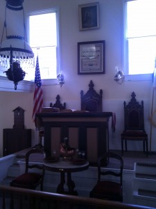 "Preaching desk and ""elder's"" chairs"